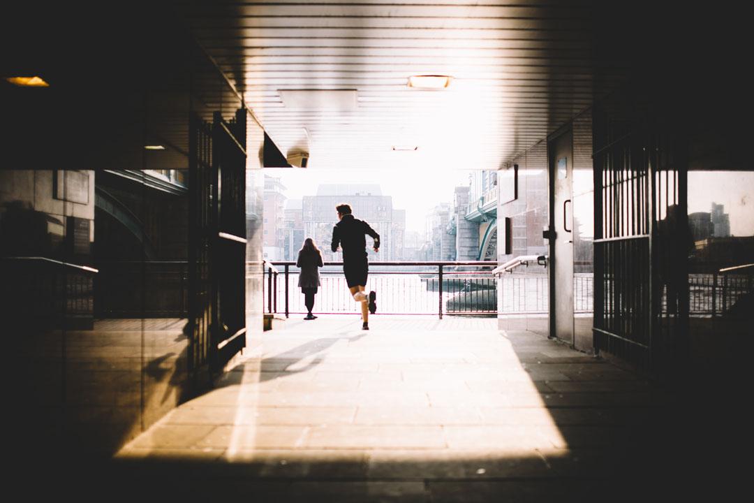 man running between buildings in the city